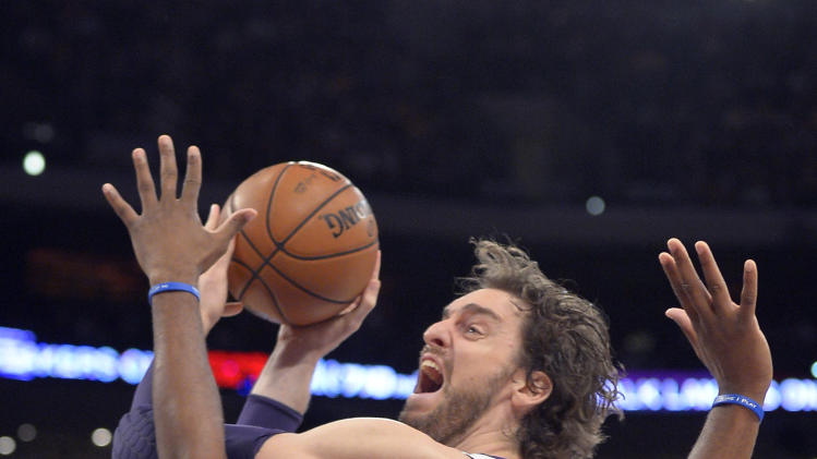 Los Angeles Lakers forward Pau Gasol, left, of Spain, puts up a shot as Detroit Pistons center Greg Monroe defends during the first half of their NBA basketball game, Sunday, Nov. 4, 2012, in Los Angeles. (AP Photo/Mark J. Terrill)