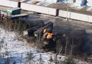 Derailed train cars burn in Plaster Rock, N.B., Wednesday, Jan.8, 2014. THE CANADIAN PRESS/Tom Bateman