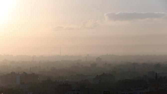 A hazy Gaza City is seen in northern Gaza strip early Friday, July 18, 2014. The heavy thud of tank shells, often just seconds apart, echoed across the Gaza Strip early Friday as thousands of Israeli soldiers launched a ground invasion, escalating a 10-day campaign of heavy air bombardments to try to destroy Hamas' rocket-firing abilities and the tunnels militants use to infiltrate Israel. (AP Photo/Lefteris Pitarakis)