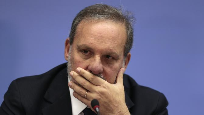 Brazil's Minister for Development, Industry and Trade Monteiro reacts during a news conference after a meeting with WTO Director-General Azevedo and Brazil's Foreign Minister Vieira, in Brasilia