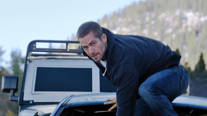 """This photo provided by Universal Pictures shows Paul Walker as Brian in a scene from """"Furious 7.""""  When the high-speed action sequel """"Furious 7"""" debuts this weekend, audiences at Hollywood's famous TCL Chinese Theatre will see every tire skid and fist fight in Imax's brand-new laser format. (AP Photo/Universal Pictures)"""