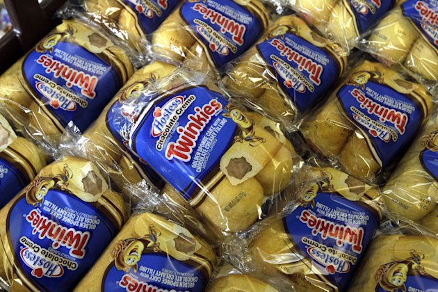FILE - In this Friday, Nov. 16, 2013, file photo, Twinkies baked goods are displayed for sale at the Hostess Brands&#39; bakery in Denver, Colo. Hostess annoucned on Thursday, Jan. 31, 2013, it has picked a lead bidder for its famous Twinkies. The bankrupt company said late Wednesday, Jan. 30, 2013, that it has selected a joint offer from two investment firms, C. Dean Metropoulos & Co. and Apollo Global Management LLC, as the lead bid for its Twinkies and other snack cakes.. (AP Photo/Brennan Linsley, File)
