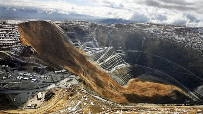 This April 11, 2013, file photo, shows the Kennecott Utah Copper Bingham Canyon Mine after a landslide in Bingham Canyon, Utah. The avalanche near Salt Lake City last year that carried enough rock, dirt and debris to bury New York's Central Park under 66 feet of rubble was North America's largest such disaster in modern history, according to University of Utah scientists. The April 2013 rockslide sent 165 million tons of debris into a nearly mile-deep pit where it cracked bedrock and triggered unprecedented earthquakes, the researchers said in a newly published study. (AP Photo/The Deseret News, Ravell Call, File) SALT LAKE TRIBUNE OUT; MAGS OUT