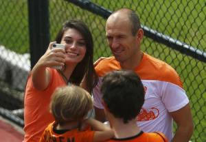 Netherlands' national soccer team player Robben poses for a photo with a fan after a training session in Rio de Janeiro