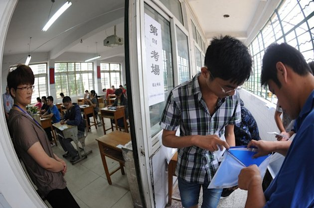 A Chinese student gets his belongings searched before taking the tough college entrance exams in Bozhou, China on June 7, 2012. More than nine million students packed exam halls across China for the opening day of the country's university entrance exam on Friday -- with attempts to stop cheating even leading to bans on metal bra clasps