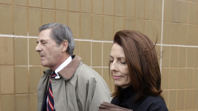 Former Michigan Supreme Court Justice Diane Hathaway leaves federal court in Ann Arbor, Mich., Tuesday, Jan. 29, 2013, with her husband, Michael Kingsley, after pleading guilty to bank fraud. Hathaway was charged three days before quitting the court because of the scandal. Hathaway pleaded guilty to bank fraud for concealing assets, including a debt-free Florida home, while urging a bank to let her unload a Michigan house in a short sale, claiming financial hardship. (AP Photo/Carlos Osorio)