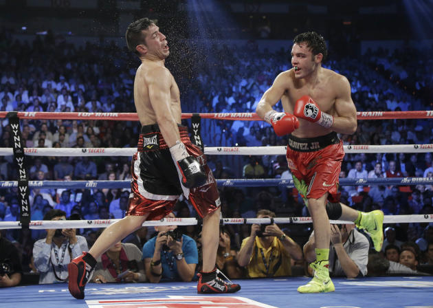 Julio Cesar Chavez Jr., right, lands a punch against Sergio Martinez during the WBC middleweight title fight, Saturday, Sept. 15, 2012, in Las Vegas. Martinez won by unanimous decision. (AP Photo/Juli