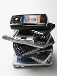 old cell phones in a stack