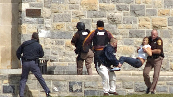 FILE - In this April 16, 2007 file photo, an injured occupant is carried out of Norris Hall at Virginia Tech in Blacksburg, Va. Thirty-two people were fatally shot in a dorm and classroom at Virginia Tech before the gunman, Seung-Hui Cho killed himself. (AP Photo/The Roanoke Times, Alan Kim, File)