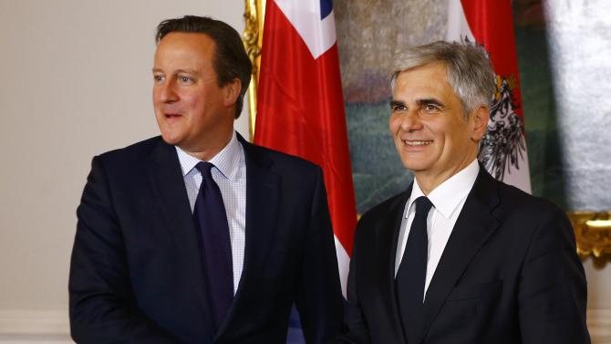 Austria's Chancellor Faymann welcomes Britain's Prime Minister Cameron in his office in Vienna