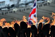This file photo shows the Olympic flame burning in the cauldron at the Olympic Stadium, on July 31. The Olympic closing ceremony on Sunday will be a &quot;beautiful, cheeky, cheesy, camp, silly and thrilling&quot; journey through British pop history, its musical director promised