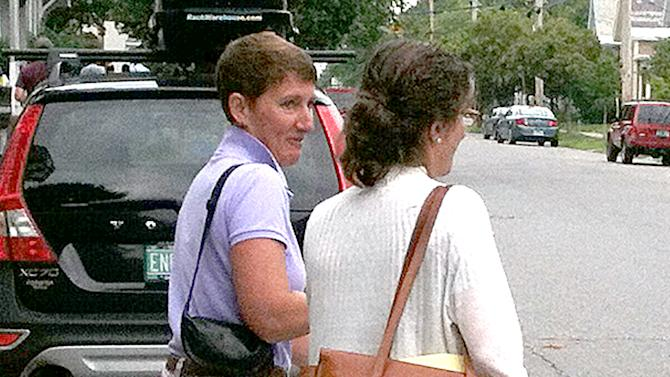 Janet Jenkins, left, leaves federal court in Burlington, Vt., on Friday, Aug. 10, 2012. Prosecutors in the trial of Kenneth Miller called Jenkins to the stand on Friday. The 46-year-old Miller is charged with helping Lisa Miller and her daughter Isabella flee the country in September 2009 after a years-long custody dispute. (AP Photo/Wilson Ring)