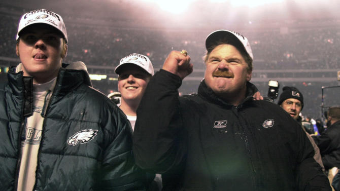 "FILE - In this Dec. 30, 2001 file photo, Philadelphia Eagles head coach Andy Reid, right, reacts to the crowd as he and his sons Garrett, left, and Britt, center, walk off the field after the Eagles beat the New York Giants 24-21, in Philadelphia. Garrett Reid was found dead Sunday, Aug. 5, 2012, in his room at training camp at Lehigh University. Police say ""there were no suspicious activities."" (AP Photo/Chris Gardner, File)"