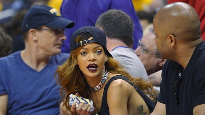 Singer Rihanna watches the Los Angeles Clippers play the Los Angeles Lakers in their NBA basketball game, Sunday, April 7, 2013, in Los Angeles. (AP Photo/Mark J. Terrill)