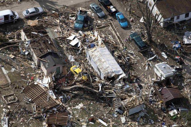 An aerial view shows cars next to wrecked houses in the wake of a tornado in Marysville, Indiana