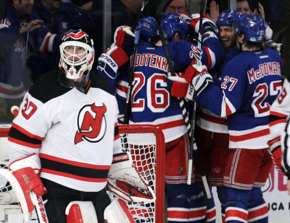 New Jersey Devils goalie Martin Brodeur looks up as New York Rangers players celebrate a goal by Marian Gaborik, of Slovakia, during the third period of Game 5 of an NHL hockey Stanley Cup Eastern Conference final playoff series, Wednesday, May 23, 2012, in New York. (AP Photo/Frank Franklin II)