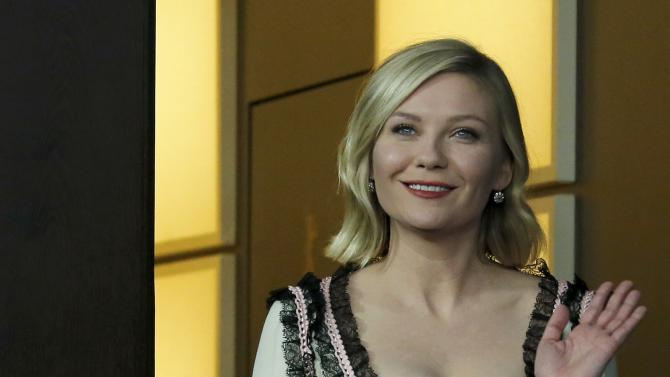 Actress Dunst arrives for photocall at 66th Berlinale International Film Festival in Berlin
