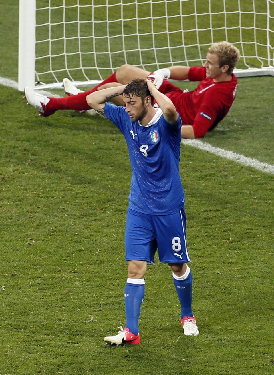 Italy's Claudio Marchisio, front, and England goalkeeper Joe Hart react after an Italy goal was disallowed during the Euro 2012 soccer championship quarterfinal match between England and Italy in Kiev, Ukraine, Monday, June 25, 2012. (AP Photo/Vadim Ghirda)