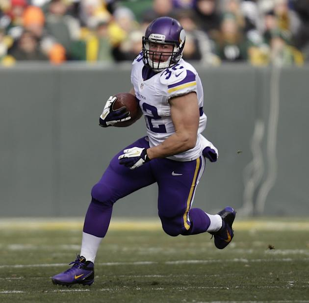 In this Nov. 24, 2013 file photo, Minnesota Vikings Toby Gerhart runs with the football during an NFL game against the Green Bay Packers at Lambeau Field in Green Bay Wis. The Jaguars contined its off