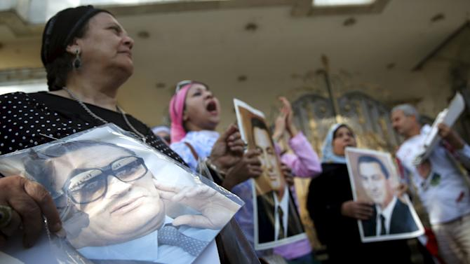 Supporters of ousted Egyptian president Hosni Mubarak cheer for him outside the area where he is hospitalized during a celebration of the 33rd anniversary of the liberation of Sinai