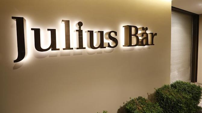 The company logo is placed beside the entrance of the headquarters of Swiss bank Julius Baer in Zurich
