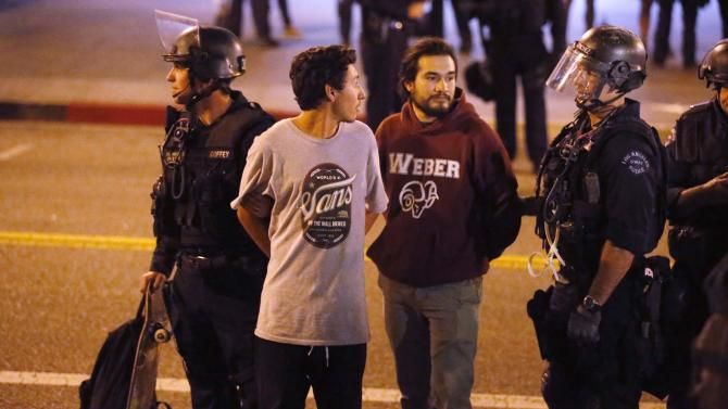 Police detain protesters during a march in Los Angeles, California
