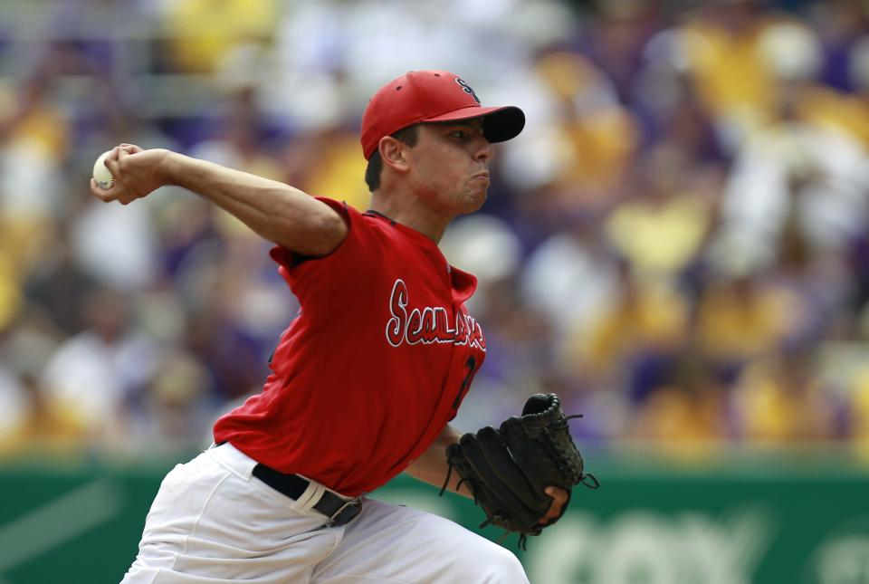 Stony Brook pitcher Brandon McNitt pitches against LSU in the first inning of an NCAA college baseball tournament super regional game in Baton Rouge, La., Friday, June 8, 2012. (AP Photo/Gerald Herbert)