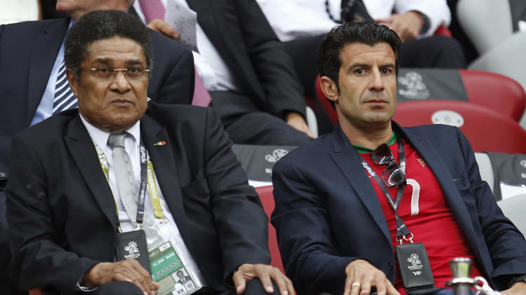 Portoguese former players Eusebio, left, and Luis Figo sit in the stands prior to the Euro 2012 soccer championship quarterfinal match between Czech Republic and Portugal in Warsaw, Poland, Thursday, June 21, 2012. (AP Photo/Armando Franca)