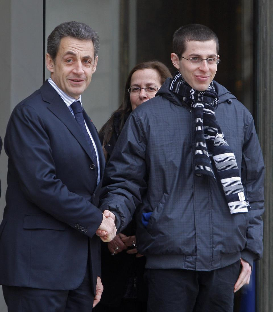 French President Nicolas Sarkozy, left, bids farewell to Gilad Schalit, an Israeli-French soldier who was held hostage for five years by Palestinian militants in Gaza, at the Elysee Palace in Paris, Wednesday, Feb. 8, 2012. (AP Photo/Michel Euler)