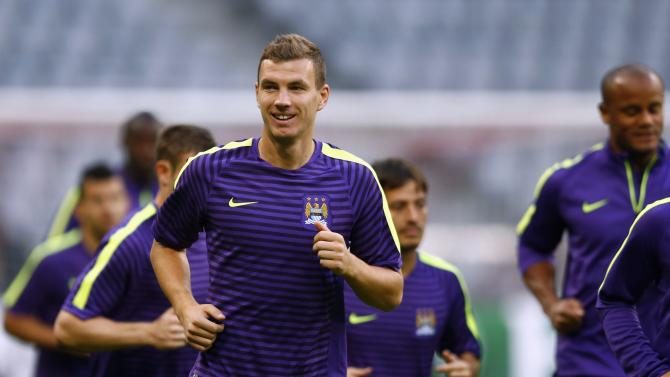 Manchester City's Edin Dzeko attends a training session before their Champions League Group E soccer match against Bayern Munich, in Munich