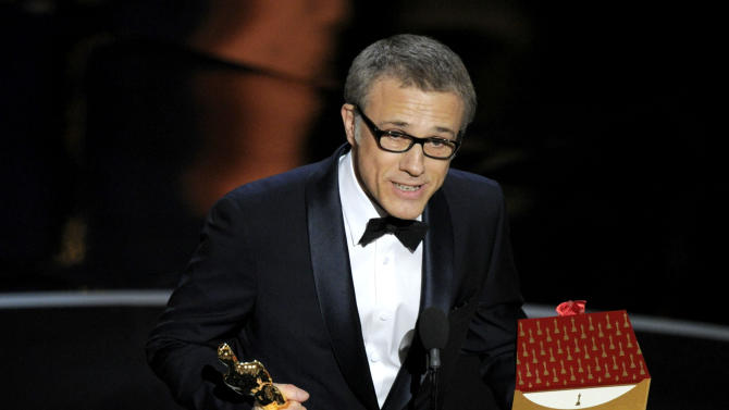 """Actor Christoph Waltz accepts the award for best actor in a supporting role for """"Django Unchained"""" during the Oscars at the Dolby Theatre on Sunday Feb. 24, 2013, in Los Angeles.  (Photo by Chris Pizzello/Invision/AP)"""