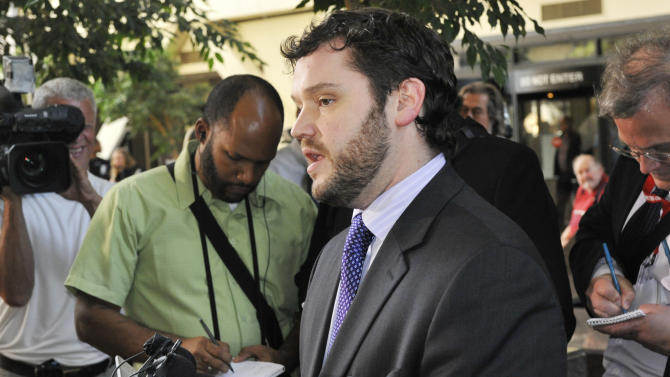 Amy Senser attorney Eric Nelson addresses the media after a jury found Senser, the wife of former Minnesota Vikings NFL football star Joe Senser, guilty Thursday, May 3, 2012, in Minneapolis on two felonies in a hit-and-run that killed Anousone Phanthavong last year. (AP Photo/Jim Mone)
