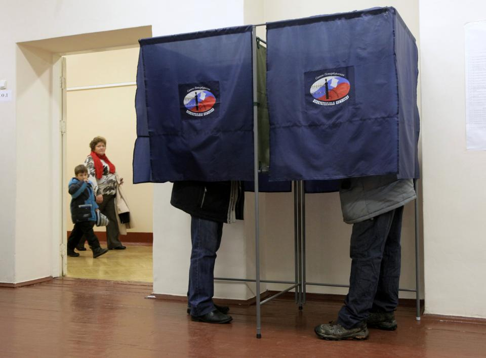 People in voting booths complete their ballots at a poling station during parliamentary elections in St. Petersburg, Russia, Sunday, Dec. 4, 2011. (AP Photo/Dmitry Lovetsky)