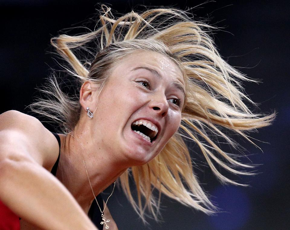 Russia's Maria Sharapova serves against Czech Petra Kvitova during their semifinal match at the Porsche Tennis Grand Prix in Stuttgart, Germany, Saturday, April 28, 2012. (AP Photo/Michael Probst)