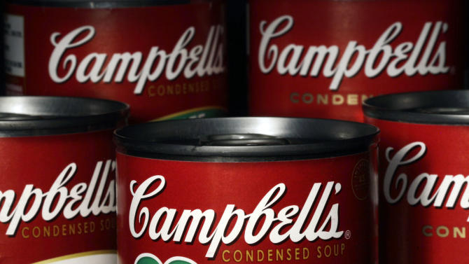 In this Wednesday, Aug. 31, 2011, photo, cans of Campbell's soup are seen in Moreland Hills, Ohio. Campbell Soup Co. announced Thursday, Sept. 27, 2012, that it will be closing two U.S. plants and cutting more than 700 jobs as it looks to trim costs amid declining canned soup consumption.(AP Photo/Amy Sancetta)