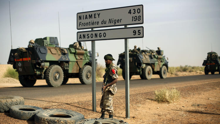 French armoured vehicles  are seen heading towards the Niger border before making a left turn north in Gao, northern Mali,  Wednesday Feb. 6, 2013. Troops from France and Chad moved into Kidal in an effort to secure the strategic north Malian city, a French official said Tuesday, as the international force put further pressure on the Islamic extremists to push them out of their last major bastion of control in the north.(AP Photo/Jerome Delay)