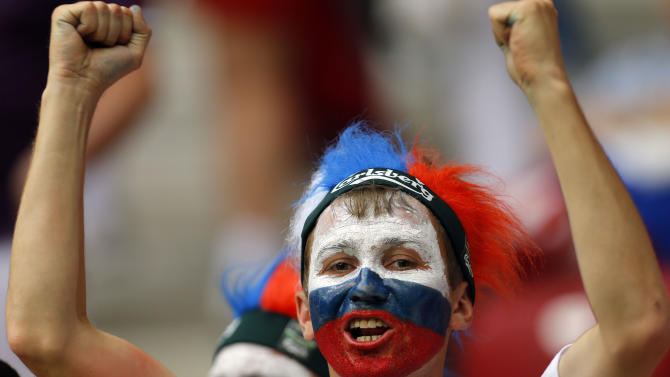 A Russian fan cheers prior to the Euro 2012 soccer championship Group A  match between Greece and Russia in Warsaw, Poland, Saturday, June 16, 2012. (AP Photo/Sergey Ponomarev)