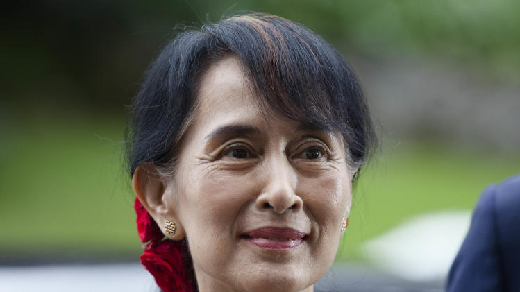 Myanmar opposition leader Aung San Suu Kyi arrives to attend a conference at the Oslo Forum at the Losby Gods mansion about 13 kilometers (8 miles) east of Oslo, Monday, June 18, 2012. The Oslo Forum is a n international network of armed conflict mediation practitioners. (AP Photo/Markus Schreiber)