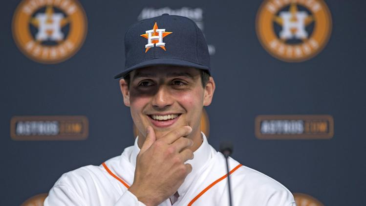 Newly-signed Houston Astros pitcher Mark Appel smiles as he answers a question during a news conference Wednesday, June 19, 2013 in Houston, to announce his signing. Appel was selected with the No. 1 overall pick in baseball's first-year player draft. (AP Photo/David J. Phillip)