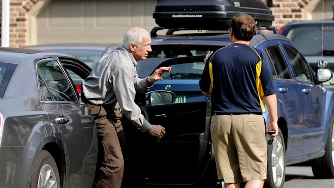 Jerry Sandusky gets out of  his Attorney Karl Rominger's car, Sunday, June 17, 2012, in Lemont, Pa. After four days of testimony that saw eight men from 18 to 28 years old tell jurors that Sandusky sexually abused them as children, the former Penn State assistant football coach could take the stand in his own defense at his criminal trial, but it's not certain that will happen as trial resumes on Monday. (AP Photo/Centre Daily Times,  Abby Drey)