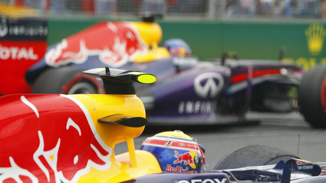 Red Bull Formula One drivers Mark Webber of Australia, front, and Sebastian Vettel of Germany wait on the grid before the start of the Australian F1 GP at the Albert Park circuit in Melbourne, Australia, Sunday, March 17, 2013. (AP Photo/Brandon Malone, Pool)