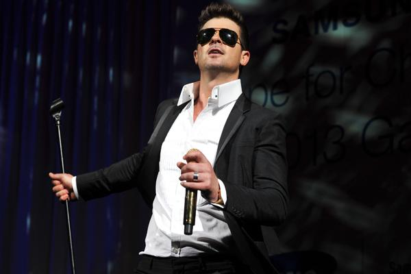 Robin Thicke, Pharrell Sue Over 'Blurred Lines'