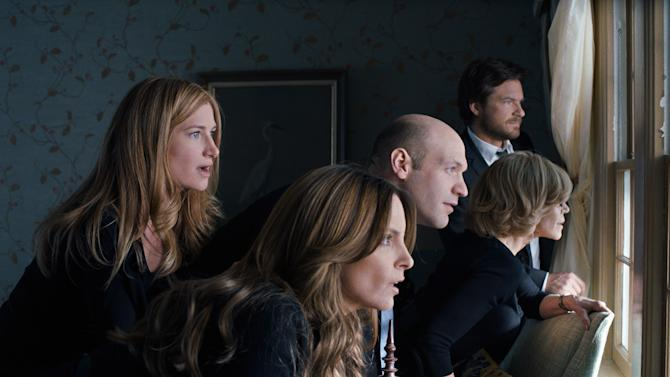 "This photo released by Warner Bros. Pictures shows, from left, Kathryn Hahn as Annie Altman, Tina Fey as Wendy Altman, Corey Stoll as Paul Altman, Jane Fonda as Hillary Altman, and Jason Bateman as Judd Altman, in a scene from the film, 'This Is Where I Leave You."" (AP Photo/Warner Bros. Pictures)"