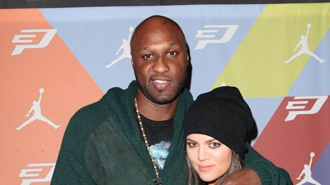 IMAGE DISTRIBUTED FOR CP3 - Lamar Odom and Khloe Kardashian at the CP3.VI Traction Control Launch Event on Saturday, Nov. 3, 2012 in Los Angeles. (Photo by Casy Rodgers/Invision for CP3/AP Images)