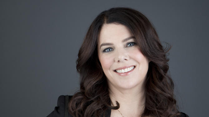 """American actress Lauren Graham poses for a portrait in promotion of her new book, """"Someday, Someday, Maybe: A Novel,"""" on Tuesday, April 30, 2013 in New York. (Photo by Amy Sussman/Invision/AP)"""