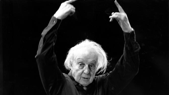 """FILE - in this Jan. 25, 1968 file photo, conductor Leopold Stokowski rehearses in the Felt Room in Madison Square Garden in New York.  A century after Leopold Stokowski (sto-KOV'-ski) took the reins of The Philadelphia Orchestra, a history detective set on his trail has tracked down rarely-seen correspondence and belongings of the conductor affectionately known as """"Stoki."""" Jack McCarthy, an archivist for the Historical Society of Pennsylvania, conducted a yearlong project for the orchestra to mark the 100th anniversary of Stokowski's 1912 appointment as conductor. (AP Photo)"""