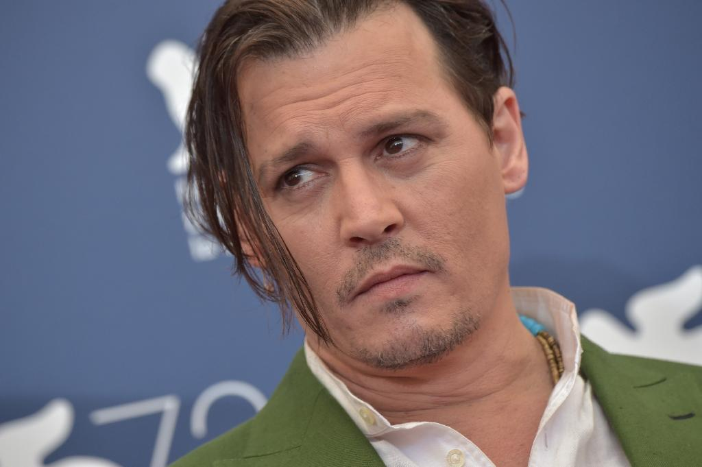 Johnny Depp's gangster role tipped in Venice for possible Oscar