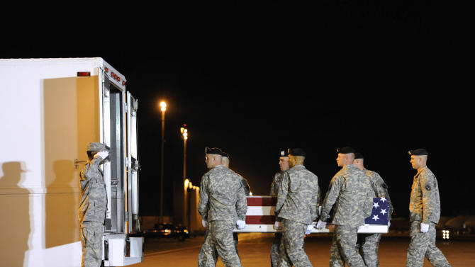 An Army carry team moves a transfer case containing the remains of American civilian Stephen Byus Wednesday, Sept. 17, 2014, at Dover Air Force Base, Del. According to the Department of Defense, Byus, 39, of Reynoldsburg, Ohio, died Sept. 16, 2014, in Kabul, Afghanistan, of wounds sustained from an enemy attack. Byus was a member of the Defense Logistics Agency Land and Maritime working as a supply specialist assigned to the Combined Security Transition Command Afghanistan. (AP Photo/Steve Ruark)