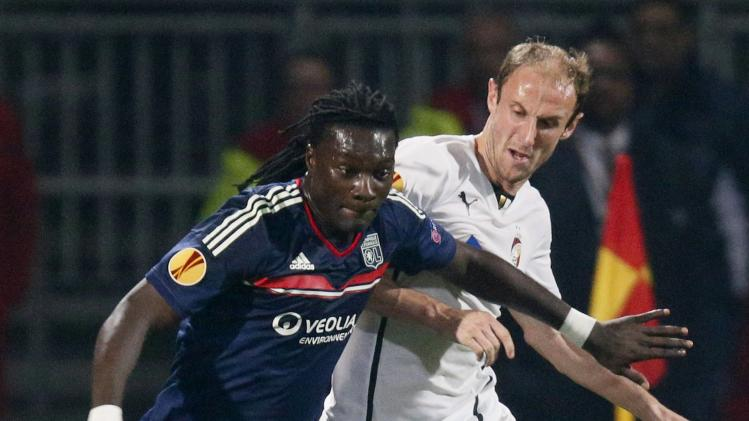 Olympique Lyon's Gomis challenges Hubnik of Viktoria Plzen during their Europa League eighths of finals soccer match at the Gerland stadium