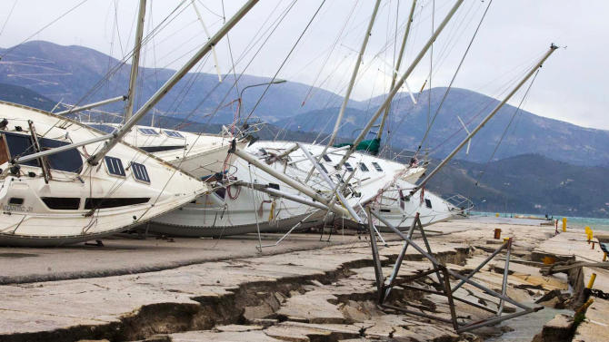 Yachts are seen knocked off their stands at a damaged dock after an earthquake in Lixouri on the island of Kefalonia, western Greece on Monday, Feb. 3, 2014. A strong earthquake with a preliminary magnitude between 5.7 and 6.1 hit the western Greek island of Kefalonia before dawn Monday, sending scared residents into the streets just over a week after a similar quake damaged hundreds of buildings, reviving memories of a disaster in the 1950s. (AP Photo)